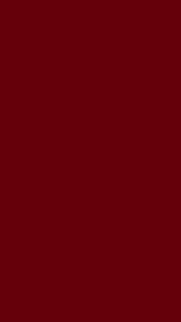 750x1334 Rosewood Solid Color Background
